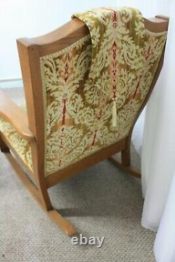 1920's Mission / Arts and Crafts upholstered oak rocking chair with foot stool