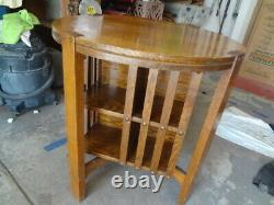 MISSION OAK TABLE with REVOLVING BOOKCASE. NO RESERVE