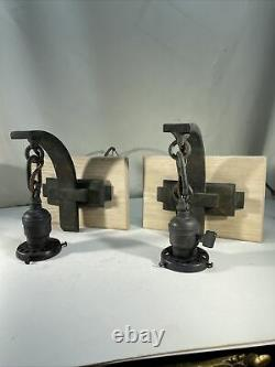 Pair antique arts crafts mission sconces on Oak